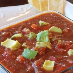 Salsa with Avocado Recipe - Cool, creamy avocado combines with sweet tomatoes and spicy jalapenos to create a refreshing salsa with just the right amount of kick!