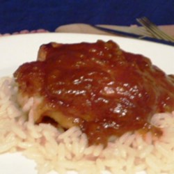 Yummy Baked Chicken Thighs in Tangy Sauce Recipe - These tender baked chicken thighs in a tangy sauce are great over rice and a hit with adults and kids alike!