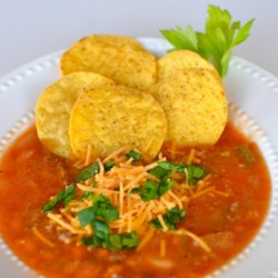 Texas New Mexico Chili Recipe - Ground beef, tomatoes, canned pinto and kidney beans are combined in this cumin and oregano seasoned chili recipe which is thickened with cornmeal.