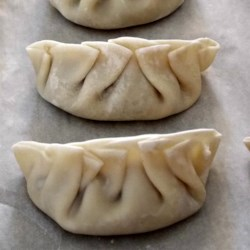 Chinese Dandelion Dumplings Recipe - Dandelion greens add a spicy bite to these pan-fried pork dumplings.