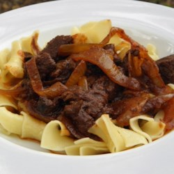 Real Hungarian Goulash (No Tomato Paste Here) Recipe - Enjoy this authentic Hungarian goulash, made with beef, onions, and Hungarian paprika, with a slice of rustic bread.