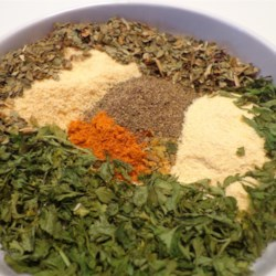All-Purpose No-Salt Seasoning Mix Recipe - A delicious blend of garlic powder, basil, thyme, savory, mace, sage, and other herbs makes any meal extra special. Make a huge batch for easy gift-giving.