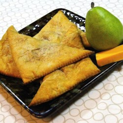 Pear Pockets Recipe - This kid-approved snack has crescent roll dough filled with Asian pear slices, peanut butter, and Cheddar cheese for a sweet and savory lunch or after-school snack.