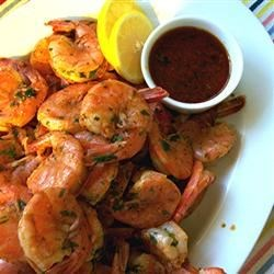 Amazing Spicy Grilled Shrimp Recipe - A blend of olive and sesame oil, hot sauce and chile sauce make this is an amazing spicy grilled shrimp recipe.