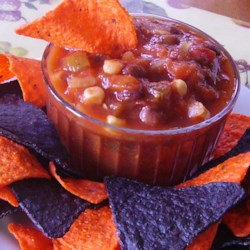 Race Day Salsa Recipe - A light and zesty salad contains smoky grilled corn kernels, black beans, and plenty of green bell pepper, onion, and jalapeno pepper in an easy tomato sauce. Serve chilled.