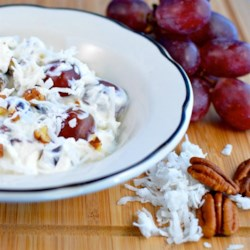 Grape and Coconut Salad Recipe - Grapes and coconut are folded into a creamy fat-free dressing creating a light and refreshing salad perfect for picnics.