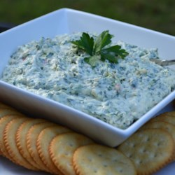 Amazing No Cook Spinach Artichoke Dip Recipe - A no-cook version of artichoke dip is quick and easy to prepare with a food processor. Combine a sweet onion, canned artichoke hearts, spinach, and sour cream for a creamy and flavorful dip.