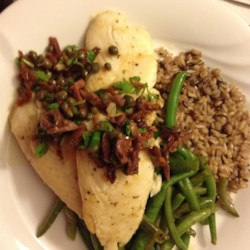 Mediterranean Tilapia Recipe - We had some beautiful tilapia fillets, but no recipes! I had recently bought some amazing sun-dried tomatoes packed in oil, and decided to invent a slightly Mediterranean fish dish for a quick weeknight dinner.  My husband is a recipe purist, always follows them to the letter, but after this, he's learned to trust my inventions!