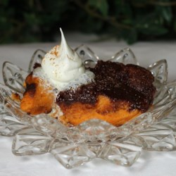 Easy Baked Pumpkin Pudding Recipe - This custard-style pumpkin pudding is the perfect addition to any holiday meal.