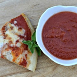 Joyce's Simple Pizza Sauce Recipe - This is a quick and easy sauce for pizza made with tomato sauce, basil, Italian seasoning, onion, and sugar.