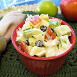 Waldorf Salad III Recipe - This creamy Waldorf Salad boasts the addition of golden raisins, fluffy whipped cream and tangy lemon and orange juices to the usual apples, celery and mayonnaise.