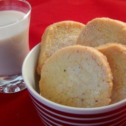Cornmeal Sugar Cookies Recipe - This is a wonderfully different crispy sugar cookie. This cookie can be made as a cut out or a refrigerator cookie. This cookie is also wonderful when dipped in melted chocolate.