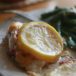 Cajun Baked Catfish Dijon Recipe - Baked catfish is smothered with a tangy, spicy sauce made with mayonnaise, Dijon mustard, lemon juice, and hot chile oil.