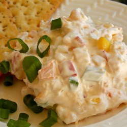 Mexican Chip Dip Recipe - Sour cream and mayonnaise make the base of this dip with Mexican-style corn, Cheddar cheese, and onion.