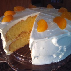 Mandarin Orange Cake II Recipe - Yellow cake with mandarin oranges in the batter. Moist and memorable. Everyone will LOVE it. Fill with a nice Italian Meringue buttercream or whipped cream and layer drained mandarin oranges on top of filling. Frost cake with remaining buttercream or whipped cream.