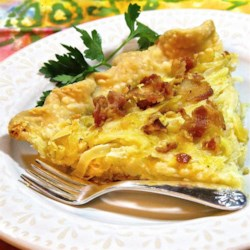 Onion Tart Recipe - This simple tart of cooked onions and bacon can be served warm or cold.