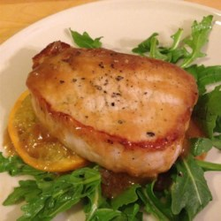 Orange Pork Recipe - Boneless pork chops are browned, then covered with a thickened orange sauce.