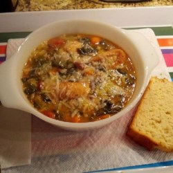 Ribollita (Reboiled Italian Cabbage Soup) Recipe - Made in the classic Italian tradition, this hearty soup combines a white bean puree with a blend of vegetables including cabbage, kale, and Swiss chard, with toasted bread to thicken the mix. It's reheated ('ribollita') and served topped with grated Parmesan and a drizzle of olive oil.