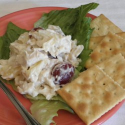 Chicken Salad with Toasted Almonds Recipe - This unusual and refreshing chicken salad is perked up by the addition of toasted almonds, tangy pineapple, crunchy water chestnuts and sweet grapes.