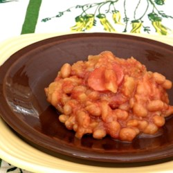 Tropical Island Baked Beans Recipe - This baked bean and smoked sausage casserole recipe uses canned crushed pineapple for a taste of the tropics in your side dish.
