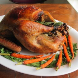 Chef John's Roast Turkey and Gravy Recipe - The biggest myth in all of American cookery is the belief that a juicy, perfectly cooked turkey is difficult for the novice cook to achieve. One of the secrets to a moist, delicious, and beautiful turkey is spreading butter under the skin. You can season the butter any way you want; the possibilities are endless.
