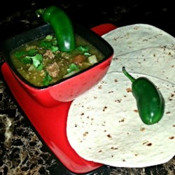 Mexican Green Chile Stew Recipe - Beef chuck and pork shoulder are simmered with green chiles and tomatoes for this hearty stew.