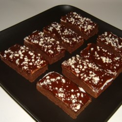 Chocolate Mint Brownies Recipe - Moist brownies are topped with a layer of mint creme and a rich chocolate glaze for a tempting treat any time of year.
