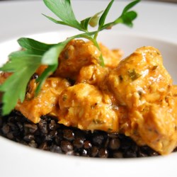 Authentic Chicken Tikka Masala Recipe - This popular Indian dish stars spiced chicken in a rich tomato and curry-based cream sauce.