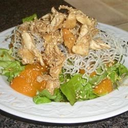 Asian Chicken Salad Recipe - This is a crunchy, wonderfully satisfying salad that is fabulous with grilled chicken, leftover from yesterday 's barbecue. The dressing is sweet and sour, mingling brown sugar with soy sauce and rice wine vinegar. Fried rice noodles add the crunch. Serves six.
