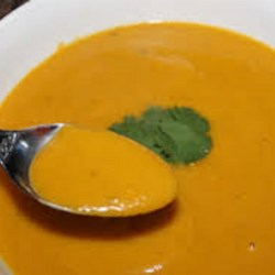 Curried Butternut Squash and Apple Bisque Recipe - Butternut squash, Granny Smith apples, prepared curry sauce, and coconut cream help this bisque recipe deliver a tasty and creamy soup to your dinner table.