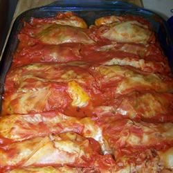 Ukrainian Cabbage Rolls Recipe - Rice wrapped in steamed cabbage leaves, covered with tomato sauce, and baked.