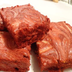 Red Velvet Brownies with Cream Cheese Frosting Recipe - Red velvet brownies are topped with a decadent, swirled cream cheese frosting for outstanding results.