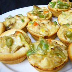 Pot Pie Cupcakes Recipe - This recipe delivers serving-size pot pies using a muffin tin and refrigerated biscuit dough.
