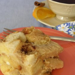 Pear Bread Pudding Recipe - Sliced pears and Poire William (pear brandy) add a flavorful touch to this homey bread pudding made with artisan-style bread.