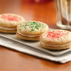 Holiday Sandwich Cookies Recipe - Sparkly, sweet and oh-so-festive, these holiday sandwich cookies start with Pillsbury(R) Ready-to-Bake!(TM) refrigerated cookies, so they couldn't be easier!