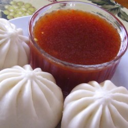 Asian Dipping Sauce Recipe - Use garlic and red chile paste to flavor this soy dipping sauce with ketchup, lemon juice, and rice wine vinegar.