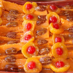 Apricot-Pecan Sweet Potatoes Recipe - Sweet potatoes are baked with an apricot sauce and chopped pecans for a treat that might become a holiday tradition in your family. Would Aunt Birdie steer you wrong?