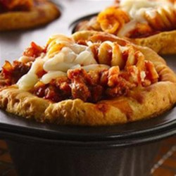 Lasagna Pasta Pies Recipe - Looking for a tasty dinner? Then check out these cheesy lasagna pasta pies made using Pillsbury(R) Grands!(R) biscuits and Italian sausage--perfect if you love Italian cuisine.