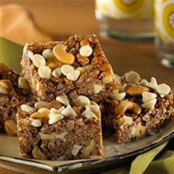 Caramel Cashew Crunch Bars Recipe - For a sweet and salty snack, try these bars, which are chock-full of cashews, white chocolate chips and melted caramel in place of marshmallows.