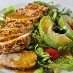 Fab Summer Blackened Chicken Salad Recipe - Pan-fried, Cajun-seasoned chicken breasts are served over mixed greens and arugula with avocado, sun-dried tomatoes, and black olives. A Dijon and balsamic vinegar based dressing brings the salad a lively flavor.