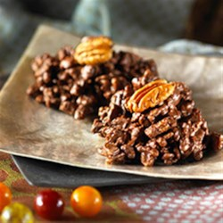 Chocolate Pecan Clusters Recipe - These smooth, chocolatey clusters melt in your mouth. And best of all, they're no-bakes.