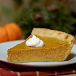 Pumpkin Pie II Recipe - Why resist? You know you can't make it through Thanksgiving without a slice of moist, delicious pumpkin pie smothered with whipped topping! Make sure the edges of your crust are high, as this recipe creates a generous amount of filling.