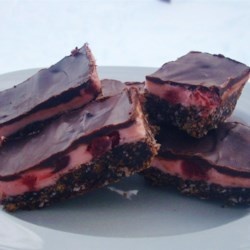 Cherry Nanaimo Bars Recipe - A great twist on the classic Canadian Nanaimo bar, these no-bake cherry Nanaimo bars have a maraschino cherry-flavored middle layer.