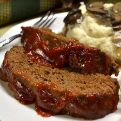 Classic Meatloaf Recipe and Video - The secrets to this meatloaf are fresh, very finely diced vegetables that give it moisture and flavor--and a light touch in mixing together the ingredients. This hearty meatloaf is the perfect meal for cool fall and winter evenings, served with mashed potatoes and simple mushroom gravy.