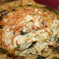 Fern's Tuna Casserole Recipe - Fern's tuna casserole has all the fixings for a night of comfort food just like grandma used to make. Potato chips sprinkled over bubbling egg noodles in cream of mushroom soup makes everyone happy.