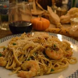 Amazing Shrimp and Langostino Lobster Linguine Recipe - Linguine with sweet onions, bacon, sauteed shrimp, and langostino lobster is the perfect dish for dinner parties!