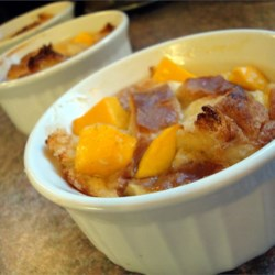 Mango Cardamom Bread Pudding Recipe - Silky smooth bread pudding made with mangos and a healthy dash of cardamom.  Passed to my mother from her girlhood friend.