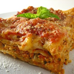Tofu Lasagna Recipe - Tofu is combined with eggs, spaghetti sauce, mozzarella cheese and spices.  The mixture is layered with lasagna noodles and topped with more cheese.
