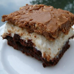 Brownie-Mallow Bars Recipe - Melted marshmallows are sandwiched between a layer of brownies and chocolate-peanut butter crispy rice cereal in this decadent dessert.