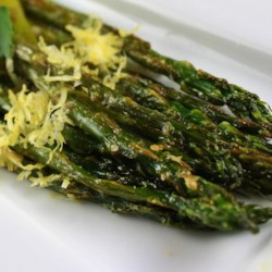 Parmesan Asparagus Recipe - A perfect side dish, fresh asparagus is roasted to perfection and topped with parmesan and garlic.